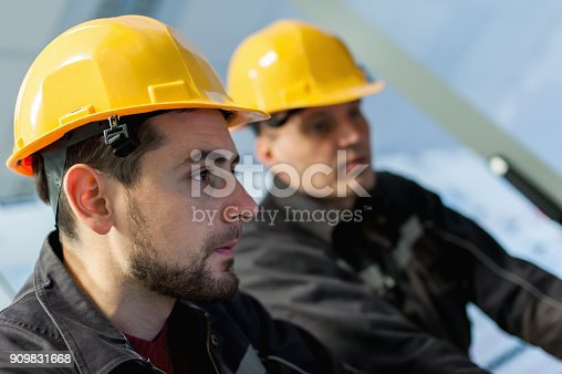 istock Two maintenance engineer work on relay protection system 909831668