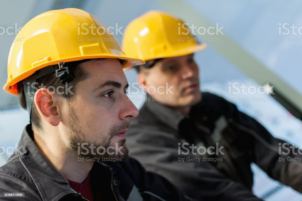 Two maintenance engineer work on relay protection system stock photo