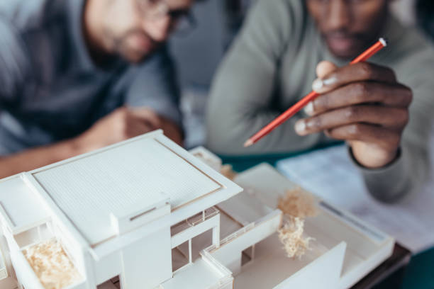 Two male architects working on new construction project stock photo
