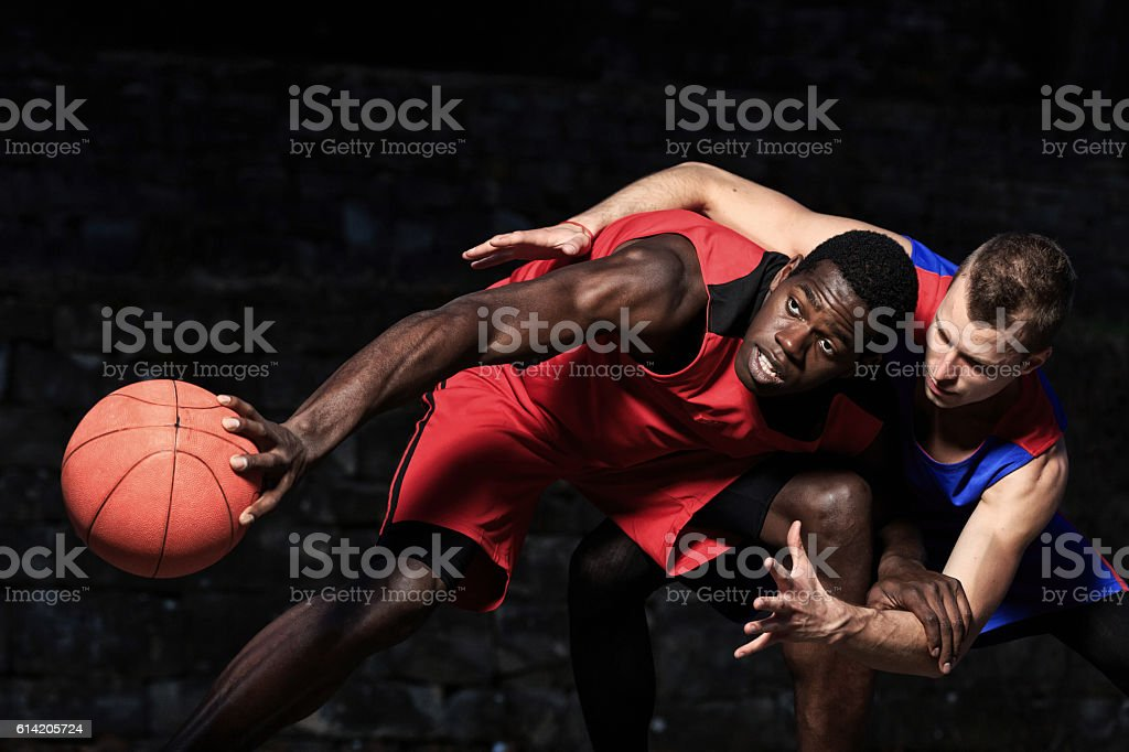 Two male basketball players on black background stock photo