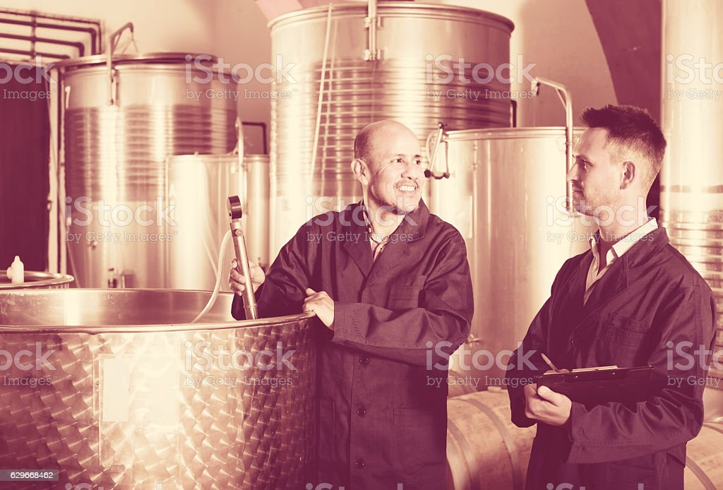 Two male employees at winery stock photo