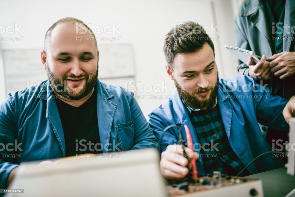 Two Male Engineers Restore Old Power Supply Boxes and Get Revised stock photo