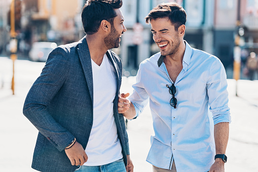 Two Male Friends Laughing On The Street Stock Photo - Download Image Now -  iStock