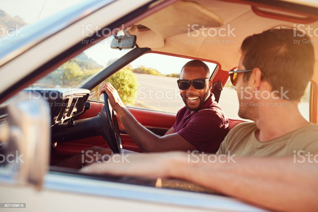 Two Male Friends Relaxing In Car During Road Trip stock photo