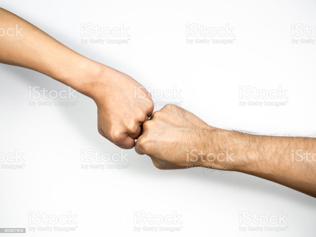 Two Male Hands Fists Together isolated on white background stock photo
