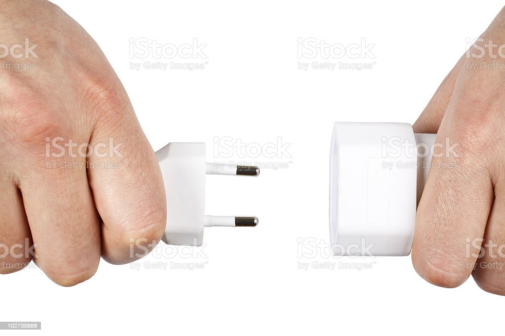 Two Male Hands Plugging a Male Plug into a Female royalty-free stock photo