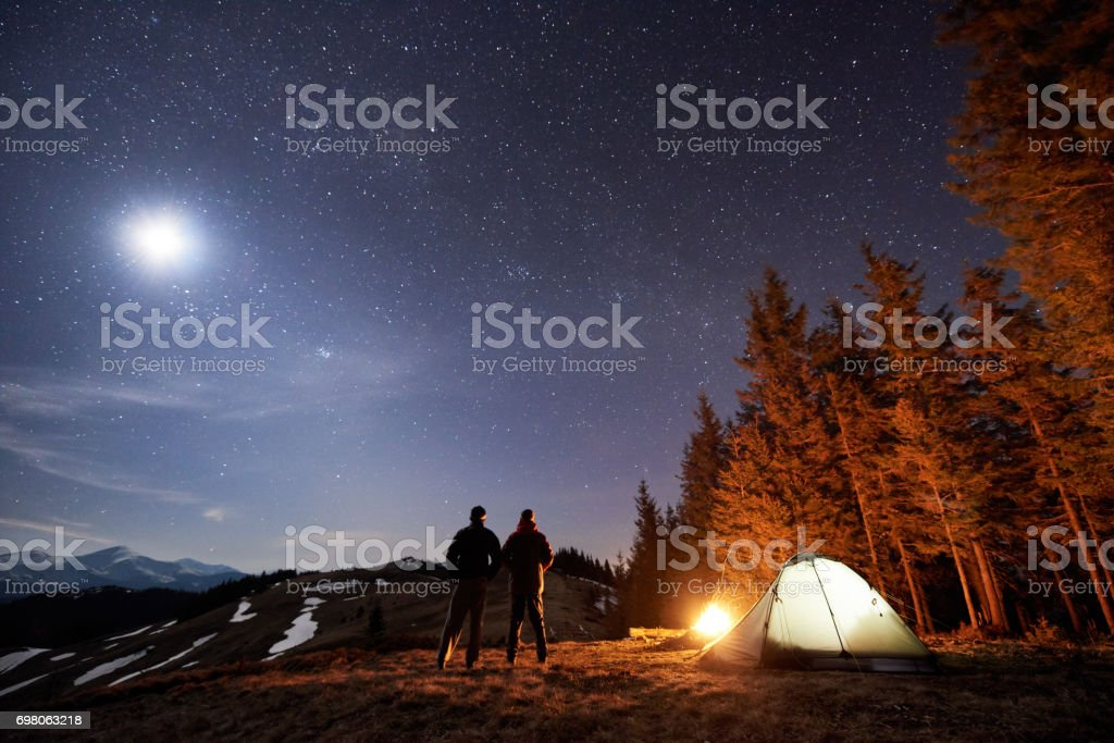 Camping in the woods at night Fire Two Male Hikers Have Rest In His Camp Near The Forest At Night Men Istock Two Male Hikers Have Rest In His Camp Near The Forest At Night Men