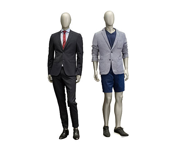 Two male mannequins dressed in suit. Two male mannequins dressed in suit Isolated on white background. No brand names or copyright objects. retail equipment stock pictures, royalty-free photos & images