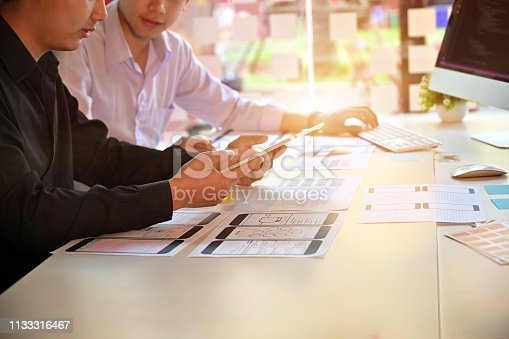 istock Two male programer working with project UX UI. 1133316467
