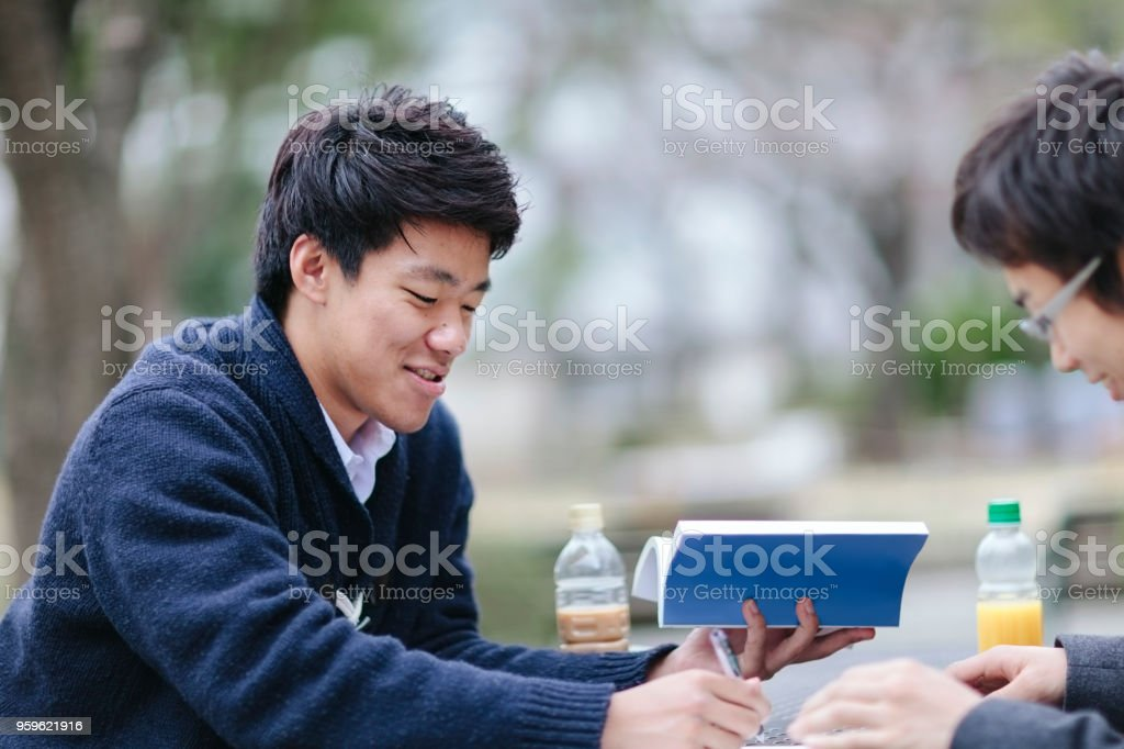 Two male students studying on campus stock photo