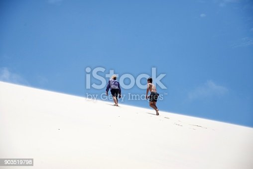 Climbing the sand dune onFraser island, nature reserve in Australia