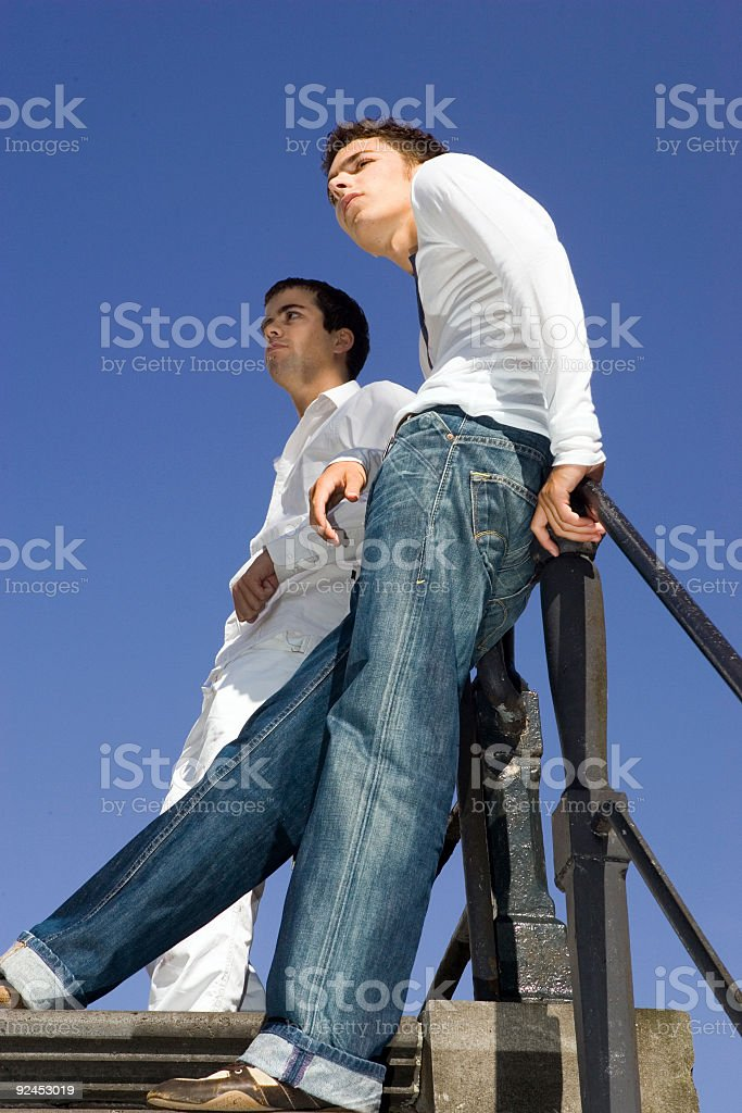 two man against blue sky royalty-free stock photo