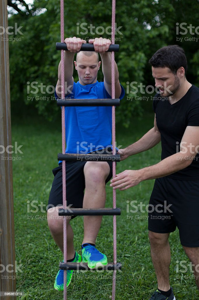 Two Man Fitness Training Outdoors royalty-free stock photo