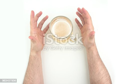 1144550840istockphoto Two Man Hands With Beer Mug Between On White Background Top View 963457936