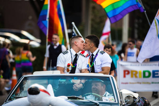 two man kissin at the  orlando pride  parade - orlando florida photos stock photos and pictures