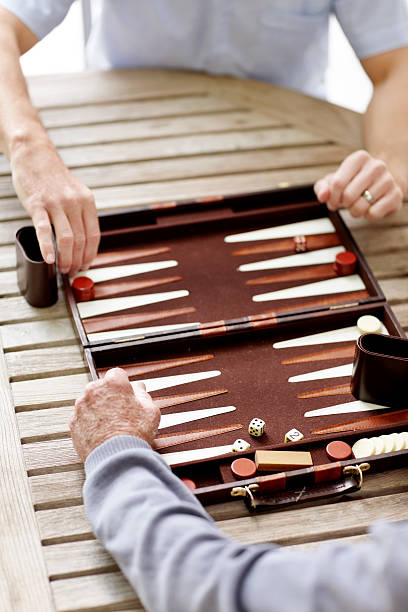 two man playing a game of backgammon - backgammon stock pictures, royalty-free photos & images