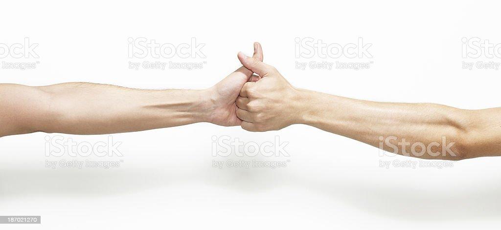Two man Thumb wrestling stock photo