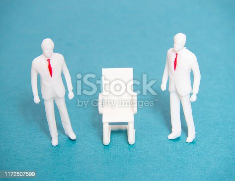 Two managers with red ties are standing near one chair, the concept of vacancy and employment in the workplace, businessman