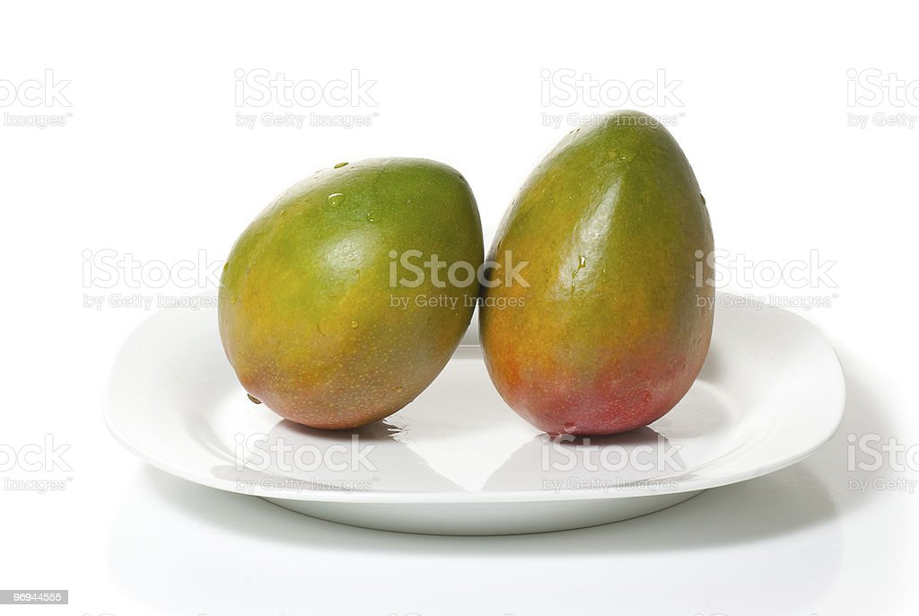 Two Mangoes On A Plate royalty-free stock photo