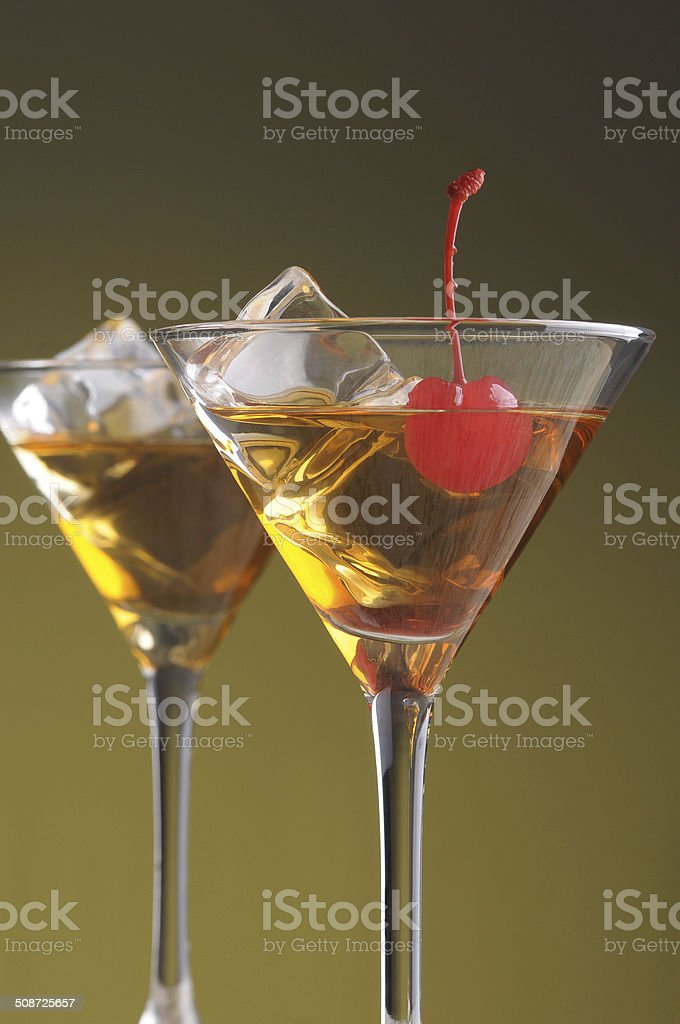 Two Manhattan Cocktails in Martini Glasses stock photo