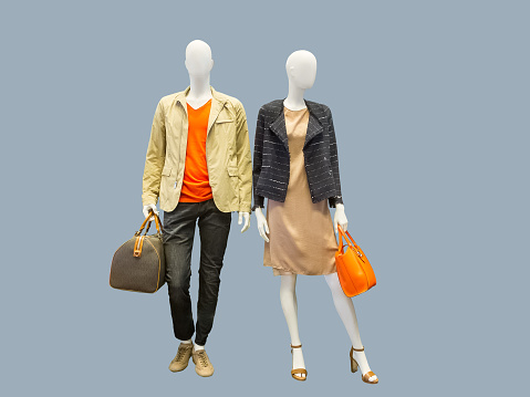 Two mannequins dressed in casual clothes