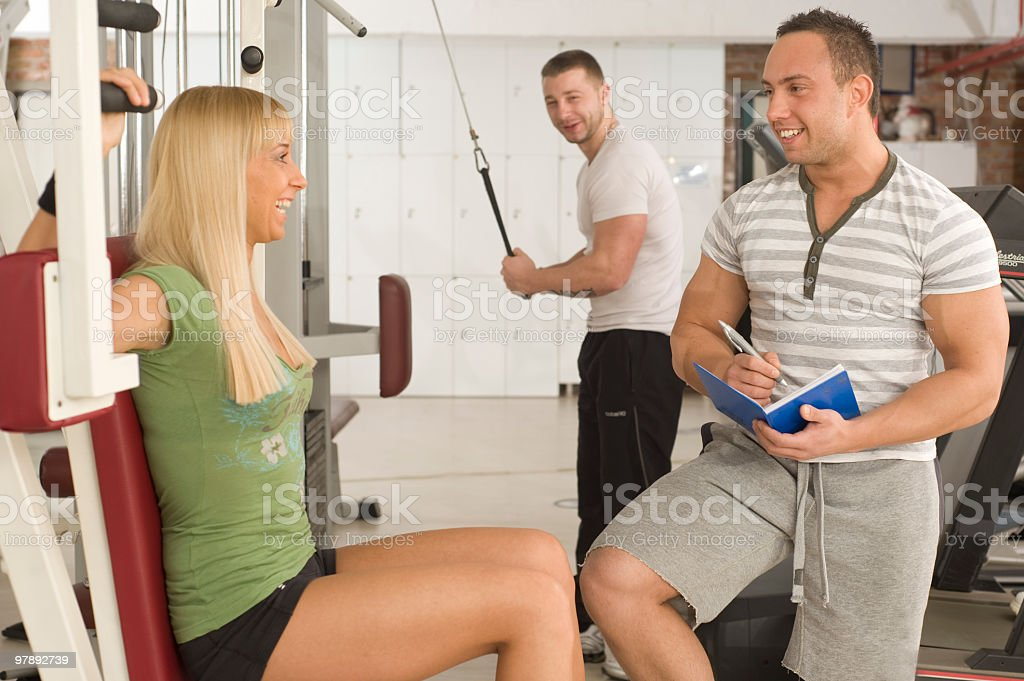 Two mans and a woman in gym royalty-free stock photo