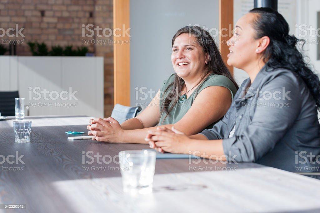 Two Maori women in business meeting stock photo