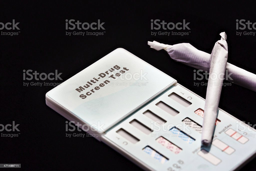 Two marijuana joints with a home drug testing kit stock photo