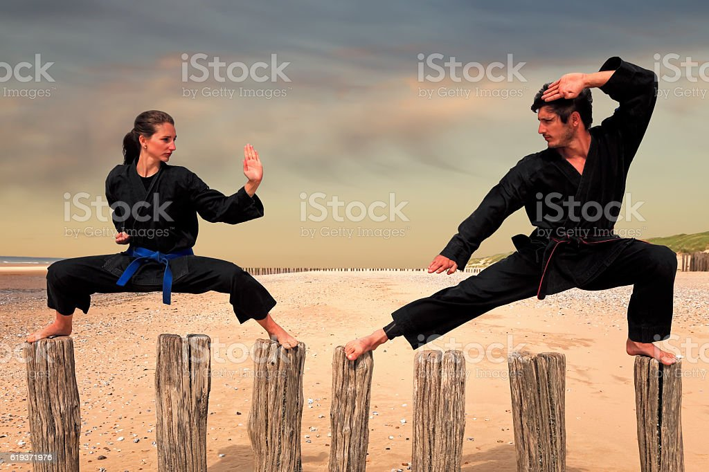 Two martial arts fighters practicing combat sport stock photo