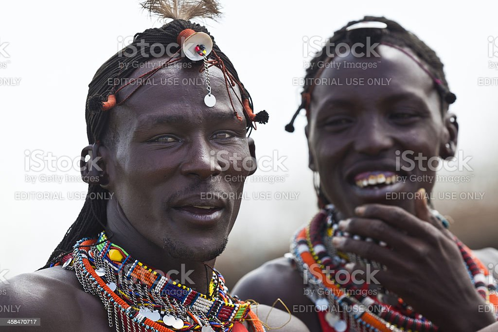 Two Masai Men Sharing a Humorous Moment stock photo