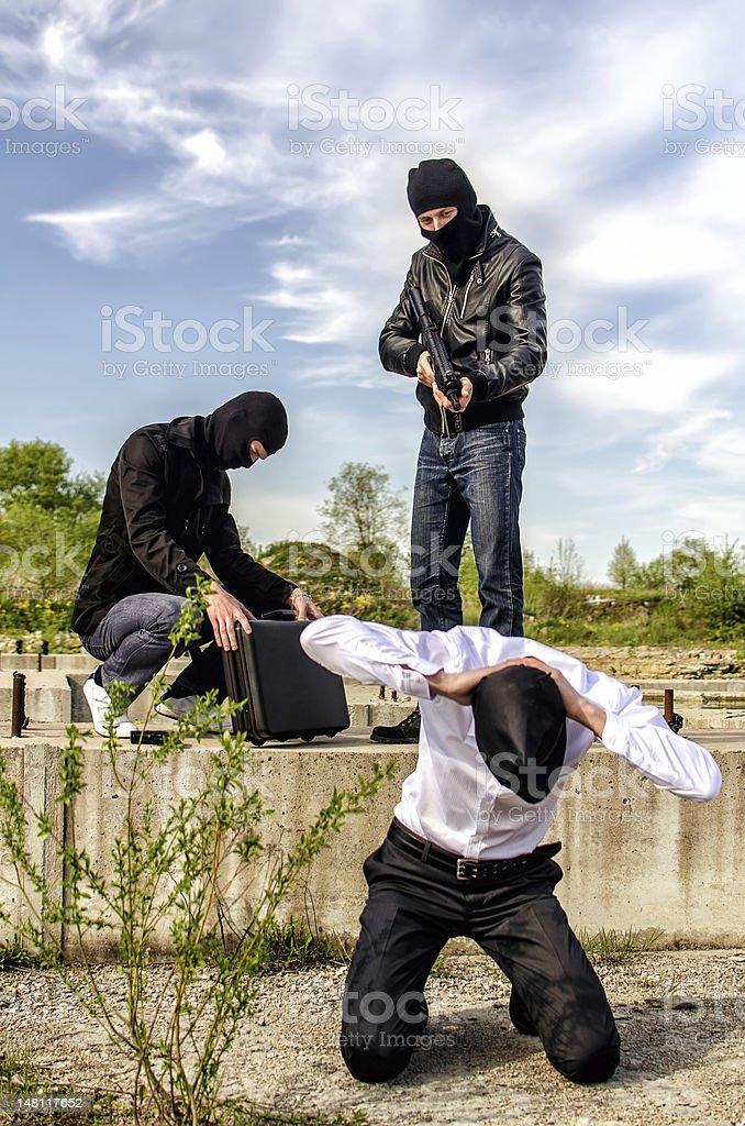 Two masked gunman trying to kill businessman stock photo