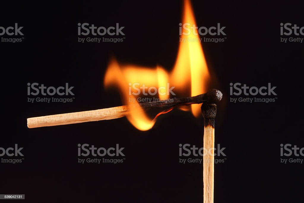 Two matches in flames stock photo