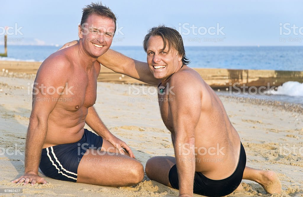 Two Mature Gay Men On Beach Stock Photo
