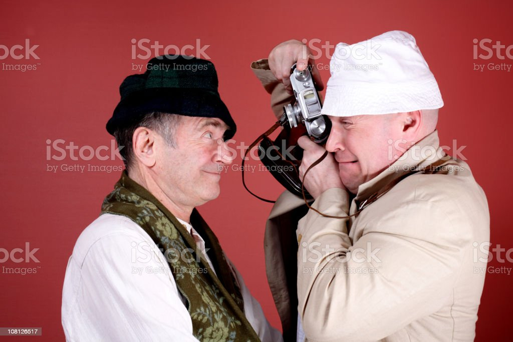 Two Mature Men Having Fun with Retro Film Camera royalty-free stock photo