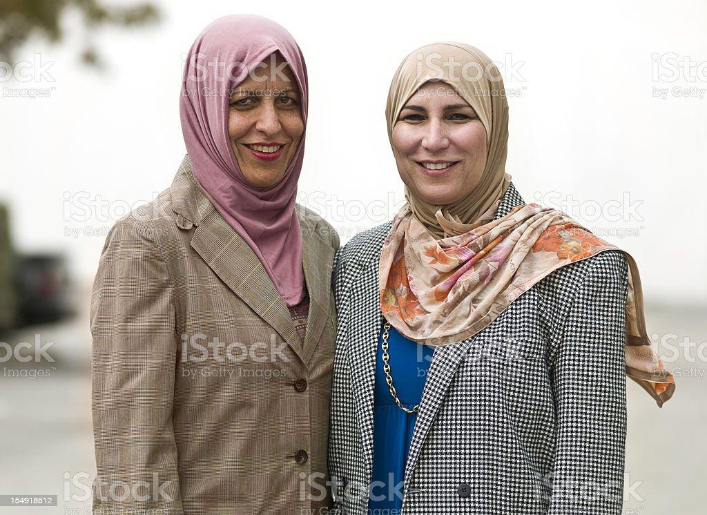 Two mature Muslim businesswomen royalty-free stock photo