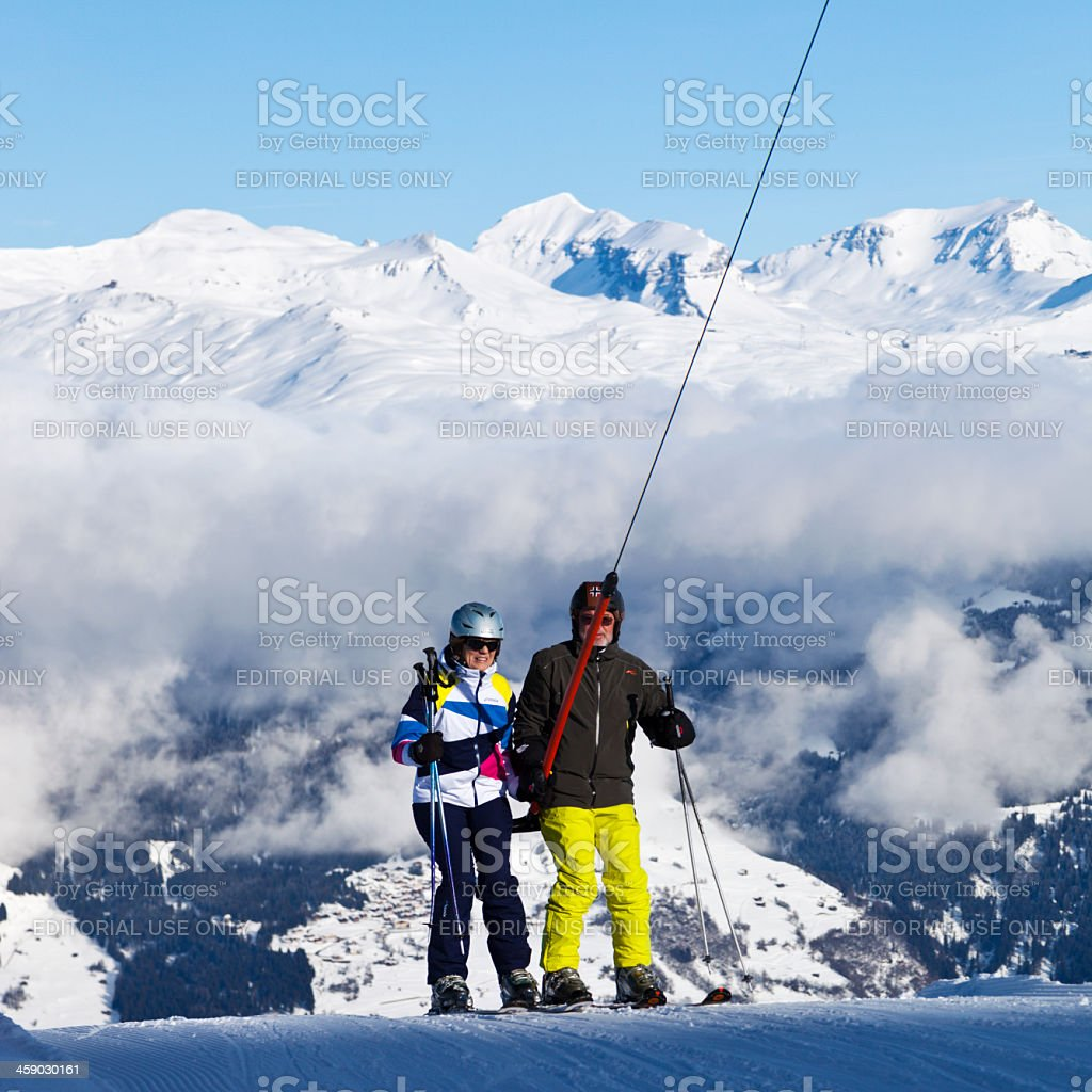 Two Mature Skiers on T-Bar Lift stock photo