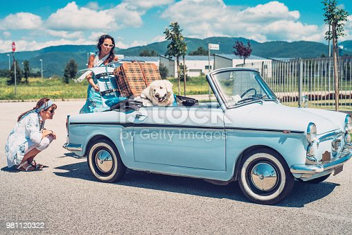 Two Mature Women With Broken Down Old-fashioned Car.