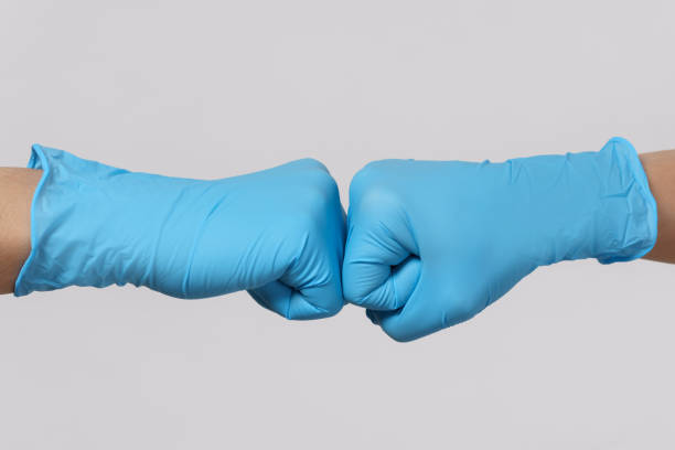 Two medical workers making a fist bump gesture. stock photo