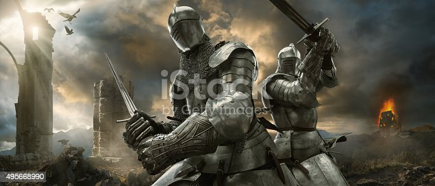 istock Two Medieval Knights With Swords On Battlefield Near Ruined Monuments 495668990