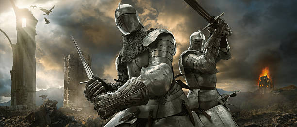 two medieval knights with swords on battlefield near ruined monuments - knights templar stock pictures, royalty-free photos & images