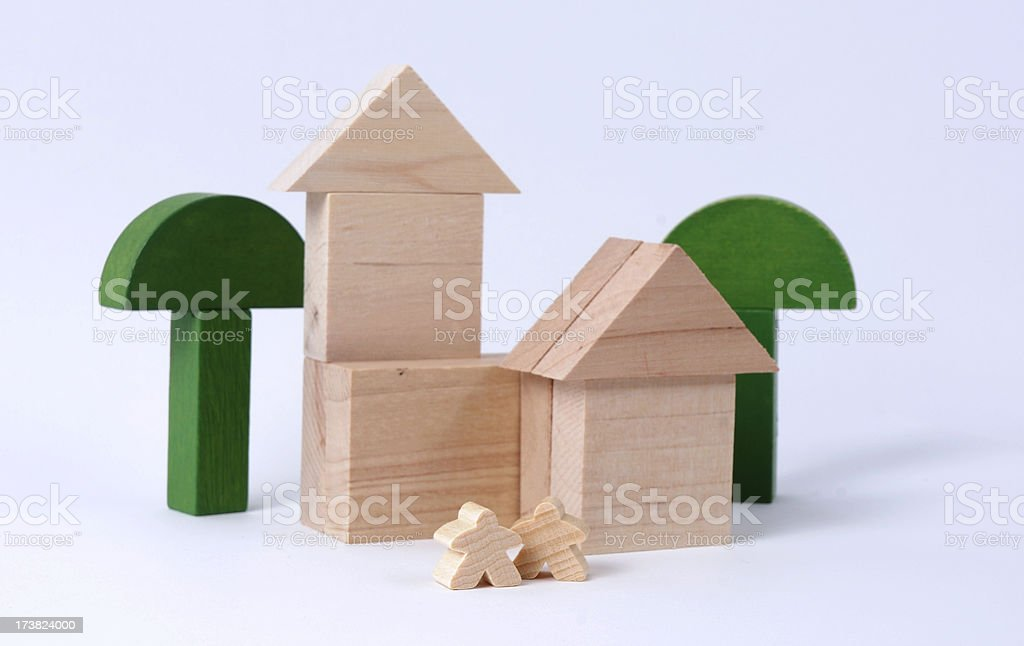 Two Meeples Outside Home royalty-free stock photo