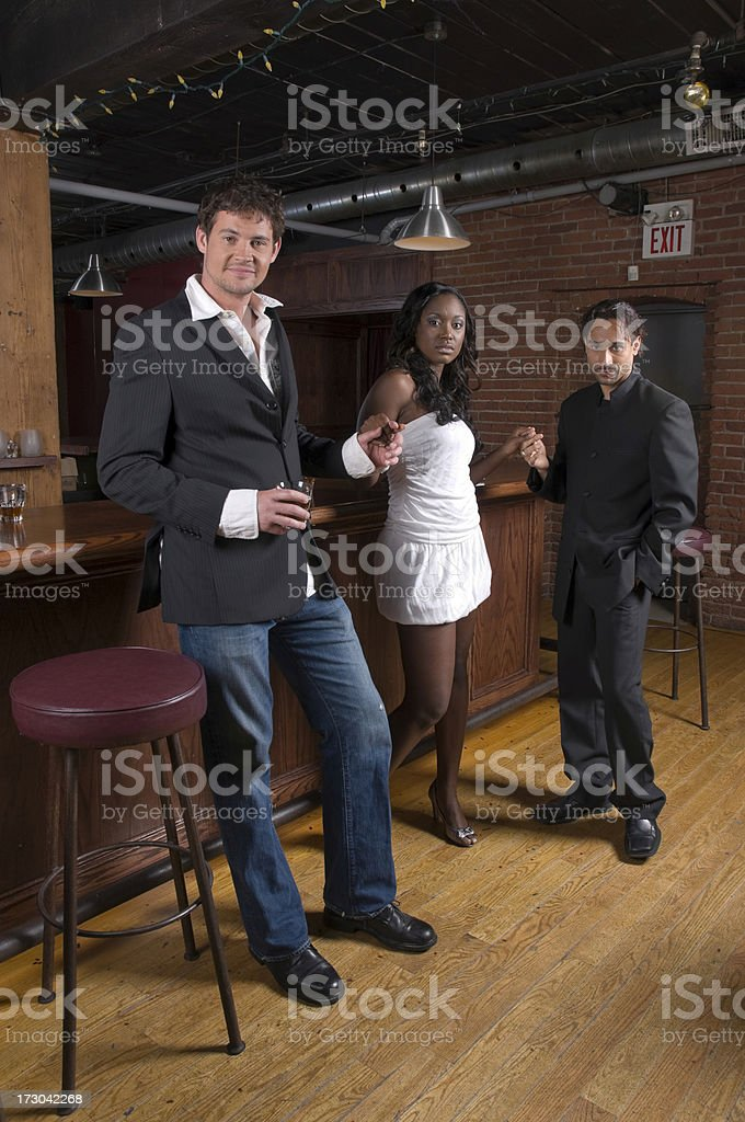 two men and a woman at the bar royalty-free stock photo