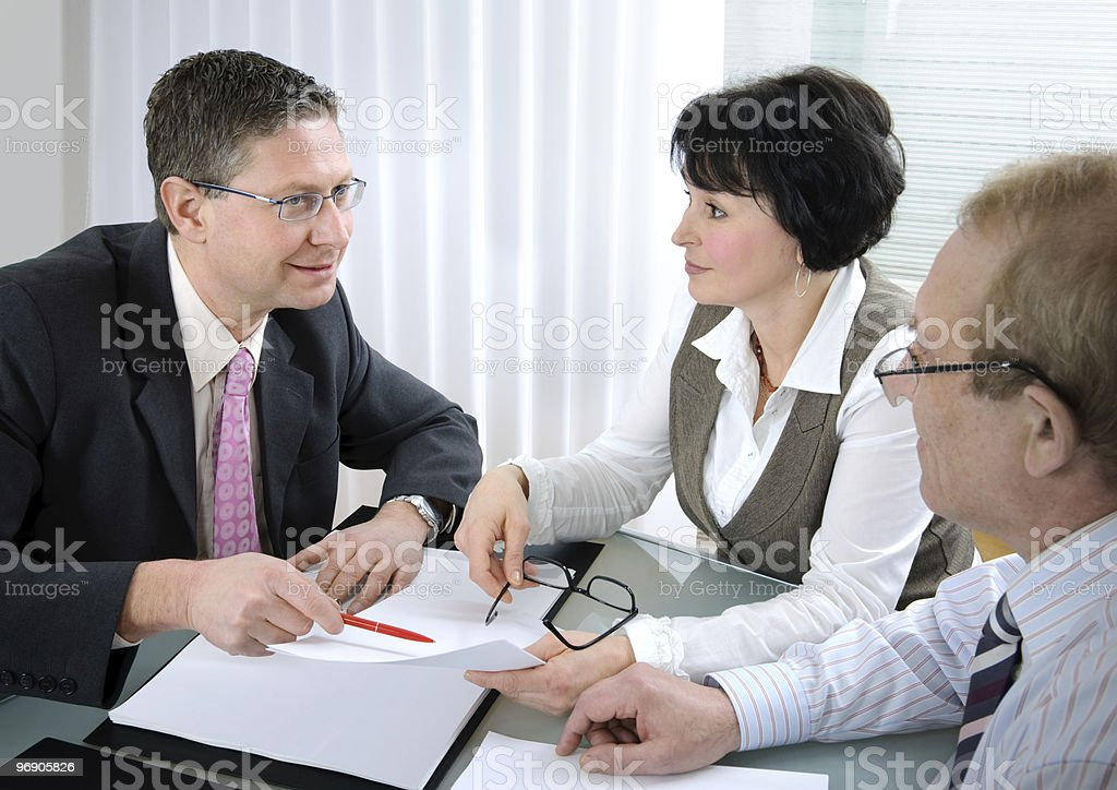 Two men and a woman in business meeting royalty-free stock photo