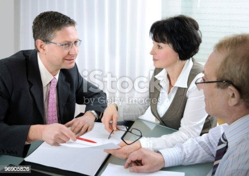 155279487 istock photo Two men and a woman in business meeting 96905826