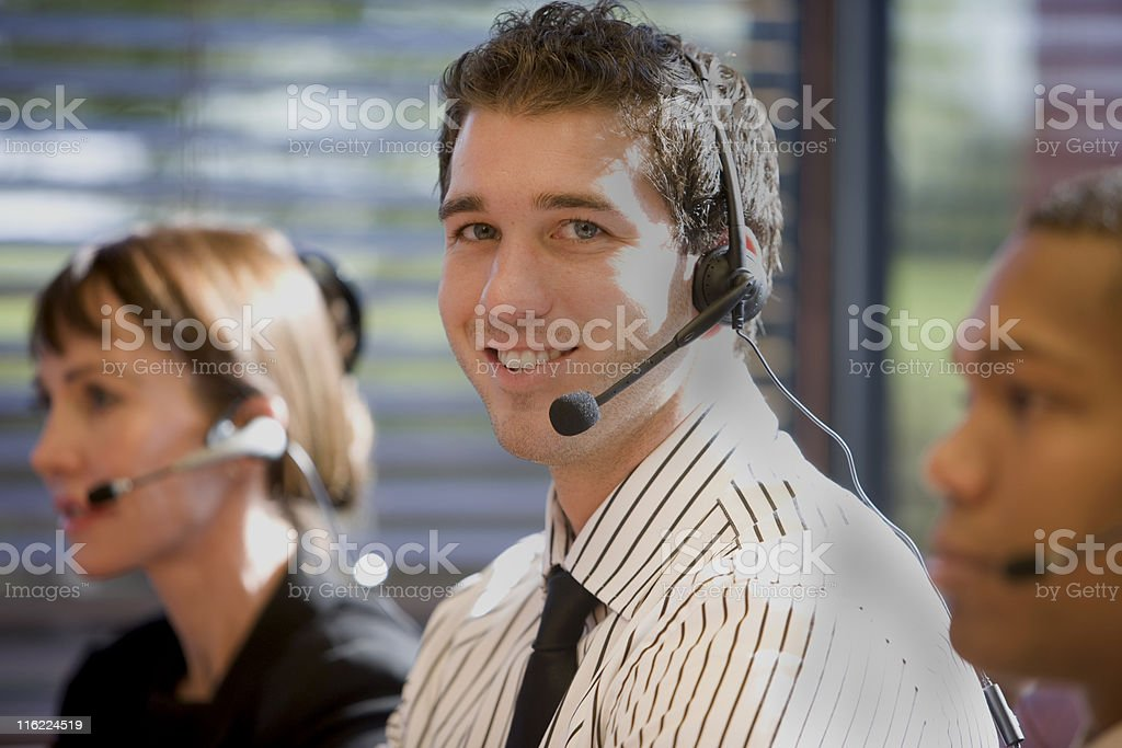 Two Men And A Woman Wearing Headsets royalty-free stock photo