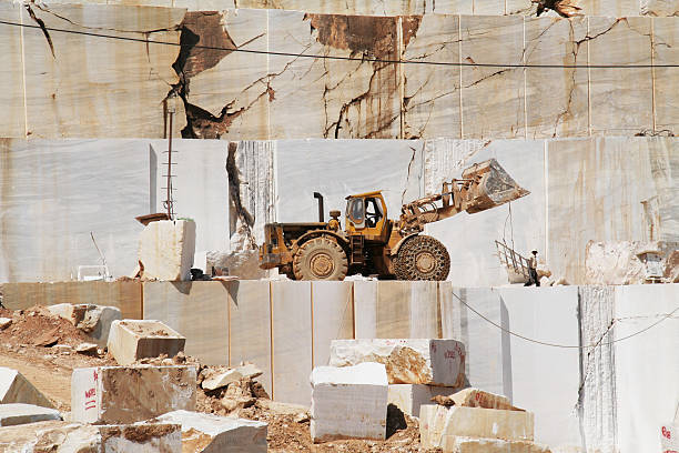 Two men and truck in Marble Quarry. Thassos, Greece (Series) stock photo