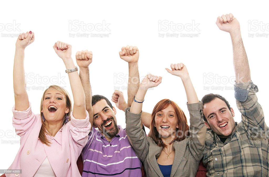 Two men and two women throwing their arms up in joy stock photo