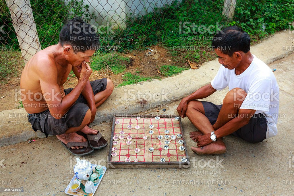 Two men are playing chinese chess stock photo