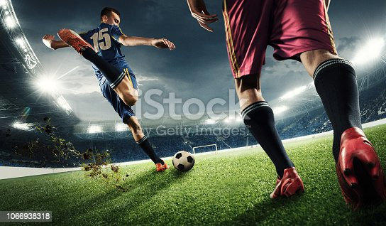 istock Two men are playing soccer and they compete with each other 1066938318