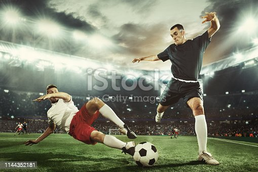 istock Two men are playing soccer and they compete with each other 1144352181